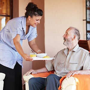 Caregiver serving dinner