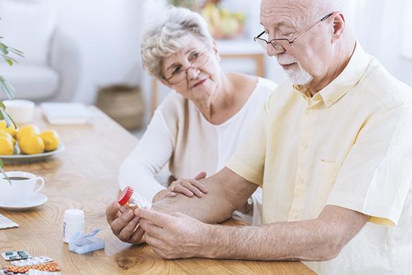 Senior couple looking at medications