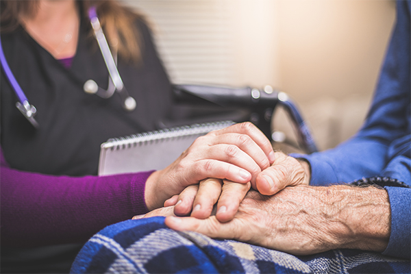 Doctor comforting senior adult