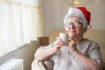 Senior woman wearing santa hat
