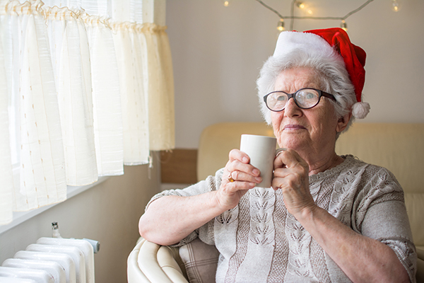 Senior woman wearing santa hat