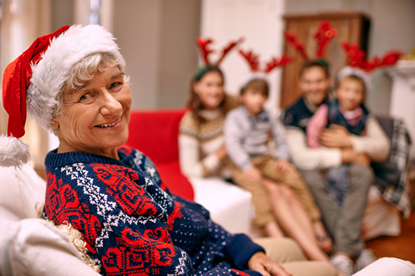 A happy grandmother with her family on Christmas Eve