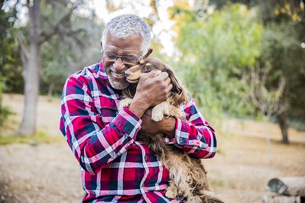 senior man playing with his dog