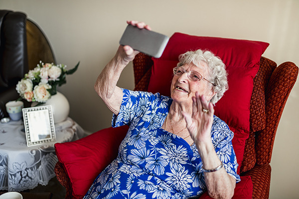 elderly woman is using a smartphone