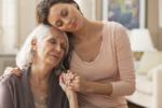 Daughter comforting senior mother
