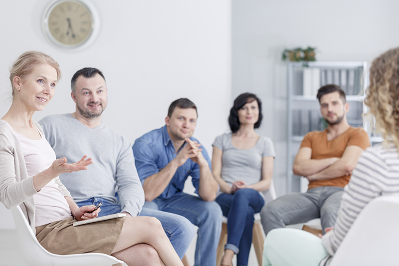 Therapist in group meeting