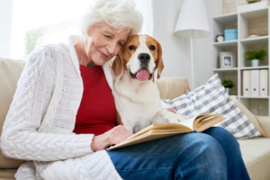 happy senior woman with dog