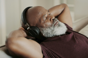 senior man relaxing and listening to headphones
