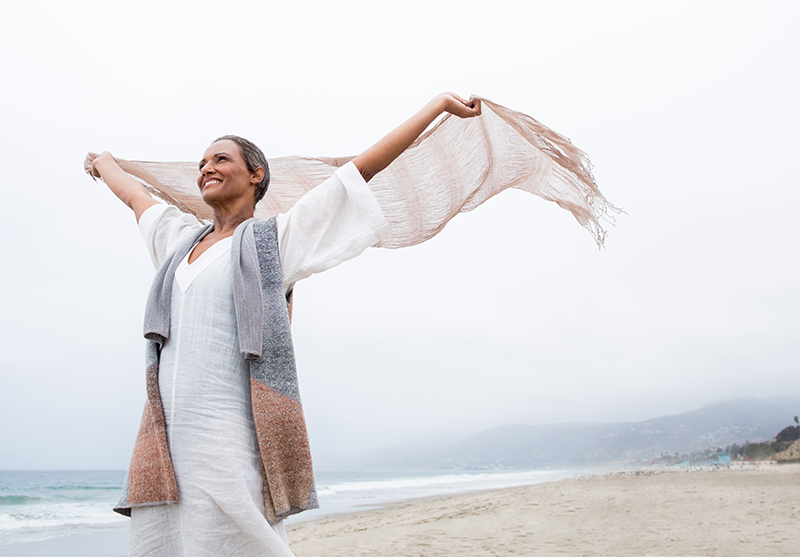 woman on beach in wind