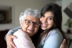senior with dementia hugging caregiver