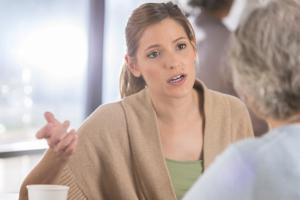 daughter talking to elderly parent