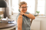 senior-woman-showing-bandage-on-arm